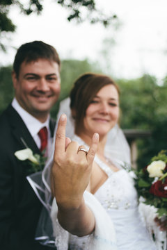 bride showing devil horns, a rock n roll icon, with her fingers