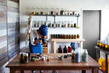 Millennial African American Woman Maker taking a photo of her products