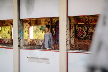 African woman looking out of an abandoned building