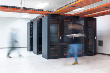 BLurred motion of people walking in a server room