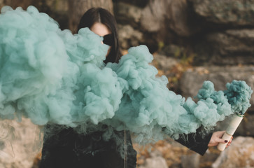 woman with green smoke bomb
