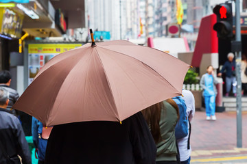 person with rain umbrella in the city