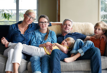 Portrait of family having fun and connecting in living room