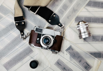Vintage camera lens and negatives