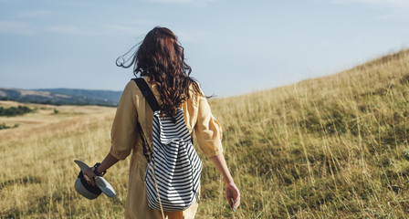 Woman With a Backpack Hiking