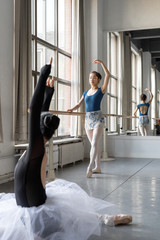 Two young professional female dancer practicing in a studio