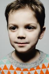 Handsome young boy studio portrait