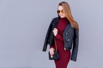 Wall Mural - Fashion woman posing on street, wear black leather jacket