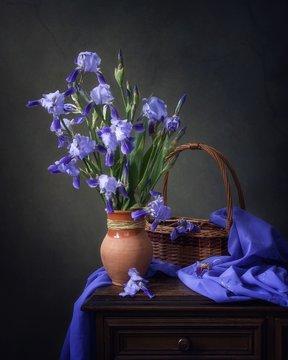 Still life with blue iris flowers