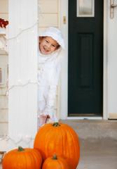 Halloween Boy Standing On Porch As Mummy