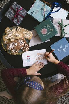 Girl Writing Christmas Greeting Card