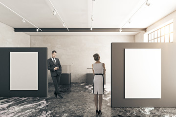 Businessman and woman in gallery