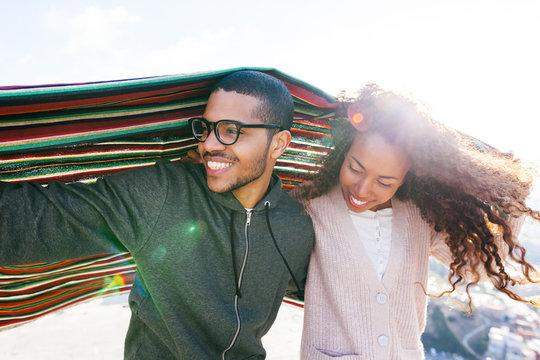 Portrait of happy couple enjoying a sunny winter day
