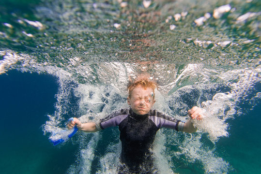 Bubbles and Underwater Splash of Boy Jumping Into Summer Lake From Water Trampoline At Cottage