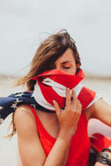 Woman Covering His Face with an American Flag