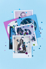 Instant photos of friends on blue background with glitter