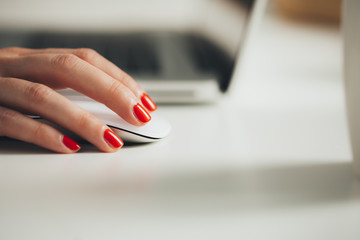 Woman's Hand on a Computer Mouse