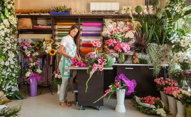 Florist working in her flower shop