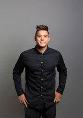 studio portrait of a confident young man