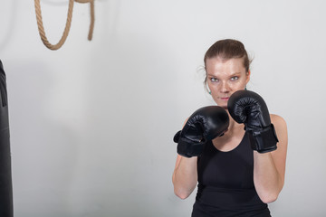 Young blonde woman in a boxing gym for a workout