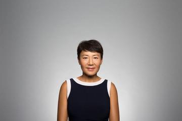 studio portrait of a confident woman