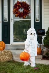 Halloween Boy Mummy Walks Towards Front Door