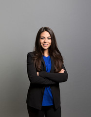 studio portrait of a happy businesswoman