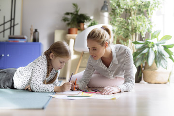 Girl Drawing With Her Mother