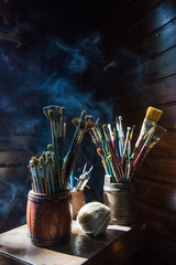 Artist's corner - assorted dirty painting brushes