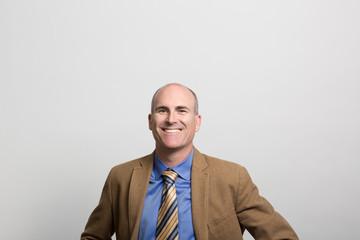 studio portrait of a happy businessman