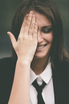 Happy young  woman with hand