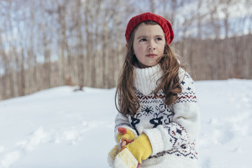 Child playing with snow outdoors