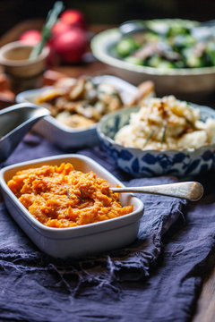 Sweet potato mash and various sides on table