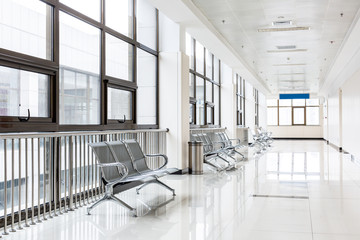 Empty chairs in waiting area at hospital