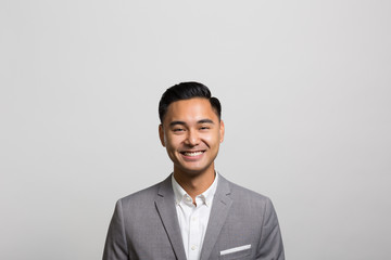 studio portrait of an excited businessman