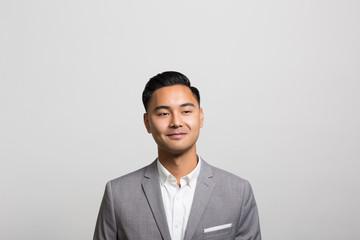 studio portrait of a confident businessman