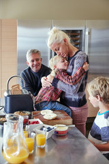 Family making breakfast together in the kitchen
