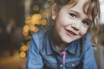 Cute preschool age girl smiling at Christmas time