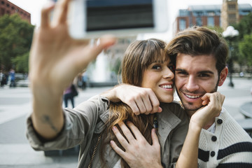 Happy couple taking a selfie in New York City