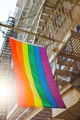 Gay flag holding from a balcony of a building