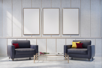 Two gray armchairs in a white living room