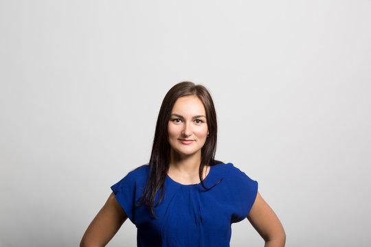 studio portrait of a confident young woman