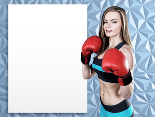 Woman in boxing gloves and a poster