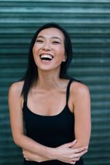 Asian Woman Smiling at Camera