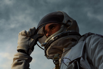 A heroic portrait of a young astronaut