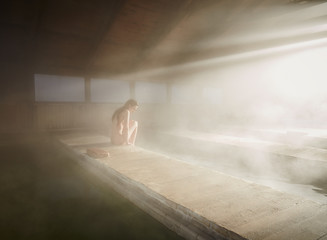 Woman relaxing at hot water spring in spa