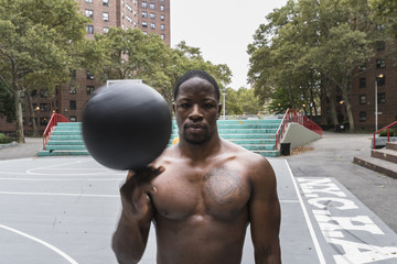 Young man playing basketball outdoors