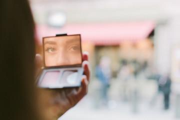 Woman looking at camera through a mirror