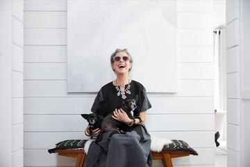Portrait of stylish senior woman with pet dogs