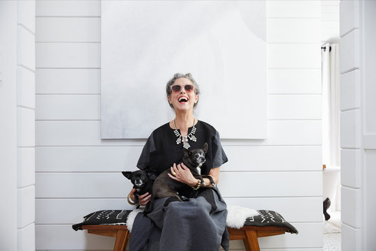 Portrait of stylish senior woman with pet dogs